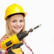 Woman holding an electric screwdriver while smiling — Foto de Stock   #13996507