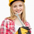 Woman holding a wrench while standing — Foto de Stock