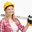 Stock Photo: Smiling womholding spirit level