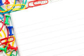 Notepad with large group of muti coloured stationery — Stock Photo