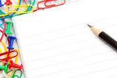 Notepad with large group of muti coloured stationery and a penci — Stock Photo