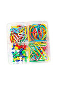 Box of multicolored of pushpins paperclips and elastics — Stock Photo