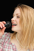 Blonde-haired woman singing — Stock Photo