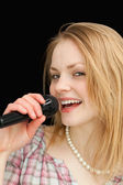 Fair-haired woman singing — Stock Photo