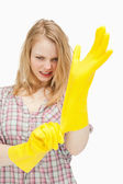 Furious woman wearing cleaning gloves — Stock Photo