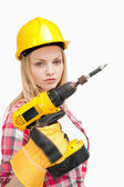Serious woman holding an electric screwdriver — Stock Photo