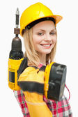 Smiling woman holding an electric screwdriver — Stock Photo
