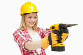 Joyful woman using an electric screwdriver — Stock Photo