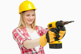 Cheerful woman using an electric screwdriver — Stock Photo
