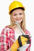 Woman holding a wrench while standing — Stock Photo