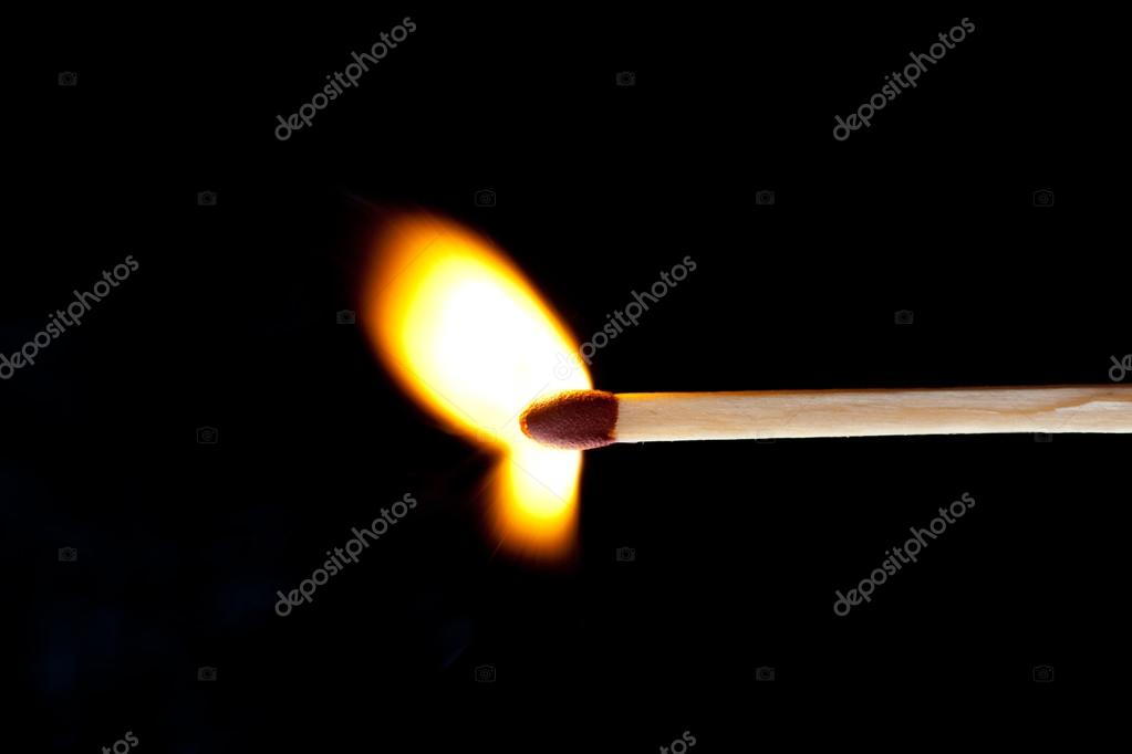 Horizontal match set on fire against a black background — Stock Photo #13990963