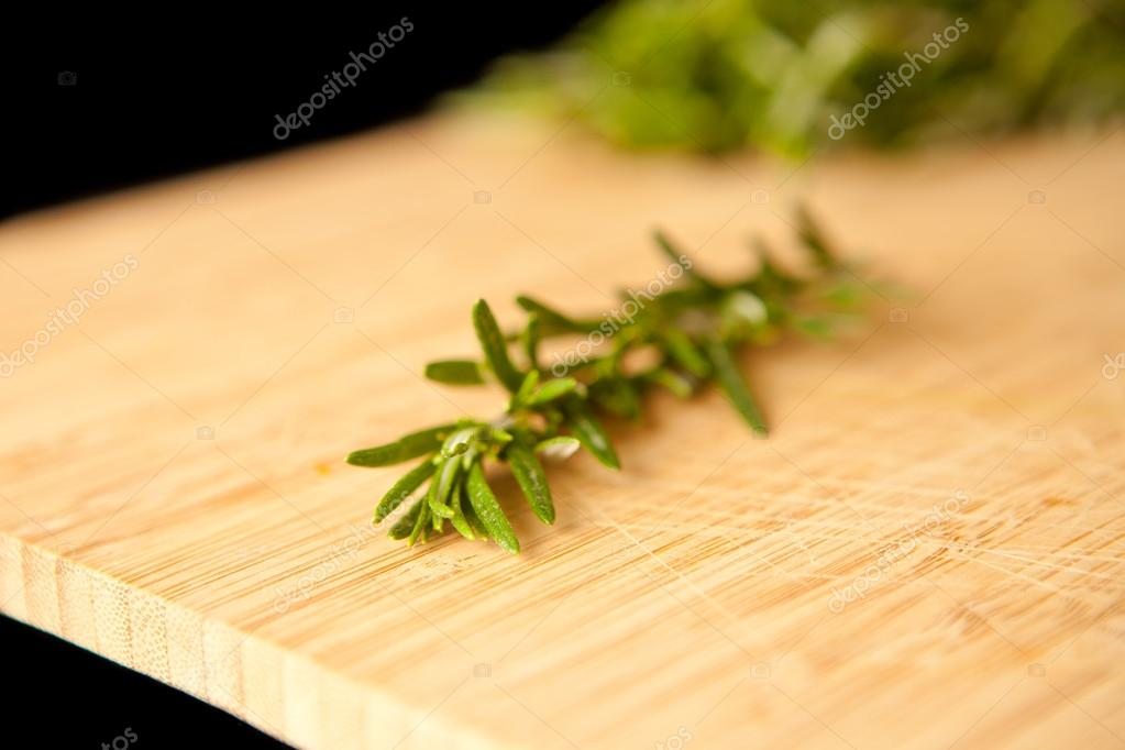 Thyme on a wooden table against a black background  Stock Photo #13990986