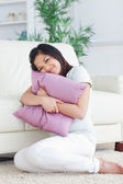 Woman holding tight a pillow — Stock Photo
