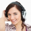 Brunette listening to music with headphones — Stock Photo