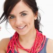 Smiling blue eyed womwith red bead necklace — Stock Photo #14071544