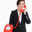 Businesswoman holding an old red phone — Stock Photo #14072126
