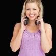 Smiling blonde woman holding her headphones — Stock Photo #14072964