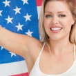 Stock Photo: Smiling womholding Old Glory flag