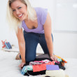 Smiling student on her luggage — Stock Photo