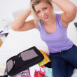 Blonde having problem to close her suitcase - Photo