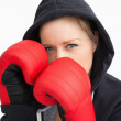 Stock Photo: Womwith hoodie boxing