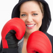 Pretty smiling woman boxing — Stock Photo