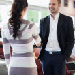 Stock Photo: Car dealer shaking hand with customer