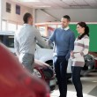 Car dealer shaking hand with a man — Stock Photo