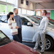 Stock Photo: Salesman talking with a couple