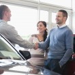 Mshaking car dealer hand — Stockfoto #14077313