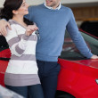 Couple standing next to a car — Stock Photo