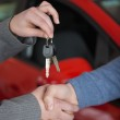 Shaking hands while holding keys — Stock Photo #14077505