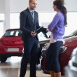 Salesman talking to a customer — Stock Photo