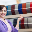 Stock Photo: Woman while pointing a color palette
