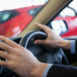 Stock Photo: Mholding steering wheel