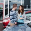 Stock Photo: Couple buying a car