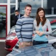 Couple choosing a car — Stock Photo