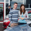 Couple choosing a car - Stockfoto