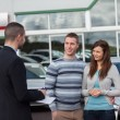 Stock Photo: Salesman talking to a couple
