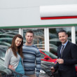 Stock Photo: Clients buying a new car