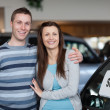 Couple purchasing a new car - Stock Photo