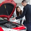 Dealer showing car engine — Stockfoto #14078146