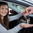 Happy client receiving car keys — Stock Photo #14078177