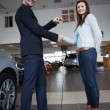 Man shaking hand with woman — Foto Stock