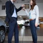 Man giving car keys to a woman — Stock Photo #14078201