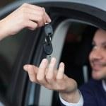 Man receiving car keys — Stock Photo