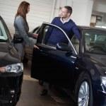 Businesswoman opening car door — Stock Photo