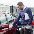 Man looking at a car door while opening it — Stock Photo