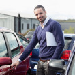 Man holding a car handle while holding a file — Stock Photo #14078429