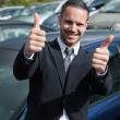Businessman raising his thumbs while smiling — Stock Photo #14078442